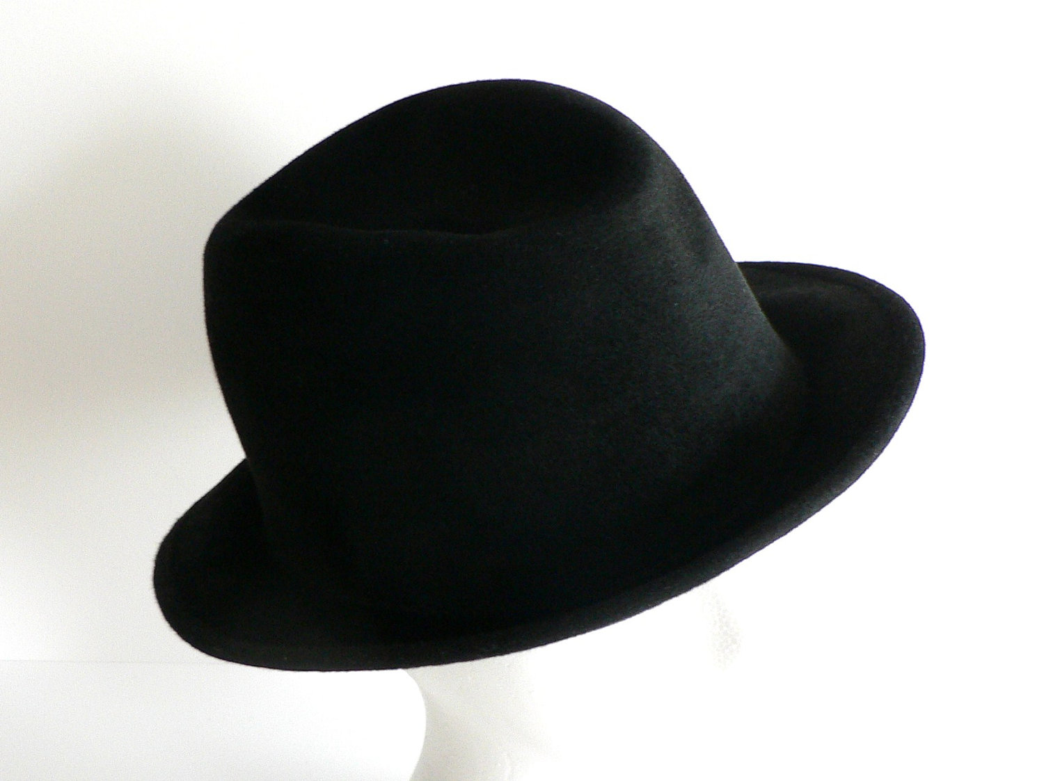 Fedora hats for men and women alike are a street-savvy fashion choice. Hats in classic colors that are fitted with ribbon hatbands are perfect for those who want to create a retro look. Hats in brighter colors and non-traditional materials such as straw and denim add a carefree-yet-edgy spin to any outfit.